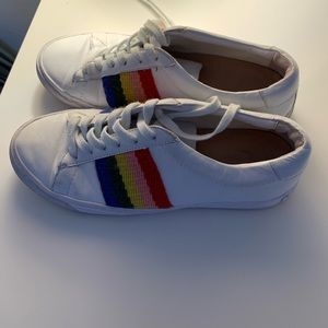 white sneakers with rainbow detail.